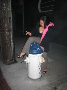 me attempting to mount a fire hydrant in front of the Rite Spot (photo by Ineke)